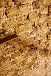 bespoke brass balustrade fixed to brick wall
