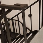 Steel staircase & balustrade painted in a matte black finish